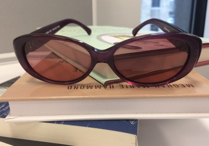 Sunglasses on books.